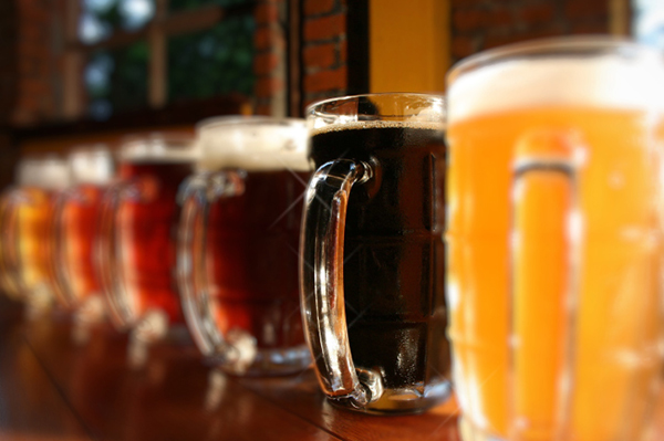 Beers lined up on a bar | Sheknows.com