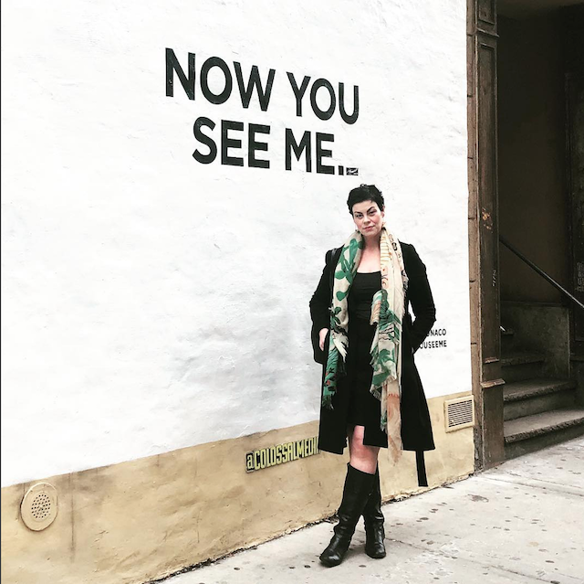 Domina Franco posing in front of a 'Now You See Me...' sign