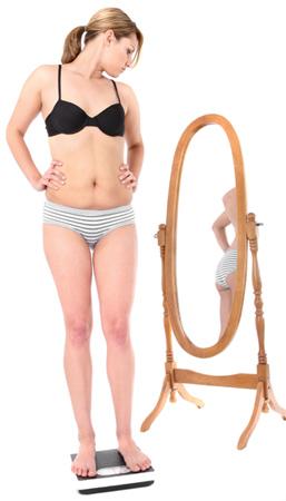 Woman in Bikini Looking at Mirror