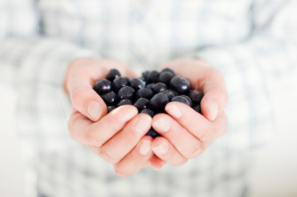 Blueberries in Woman's Hands