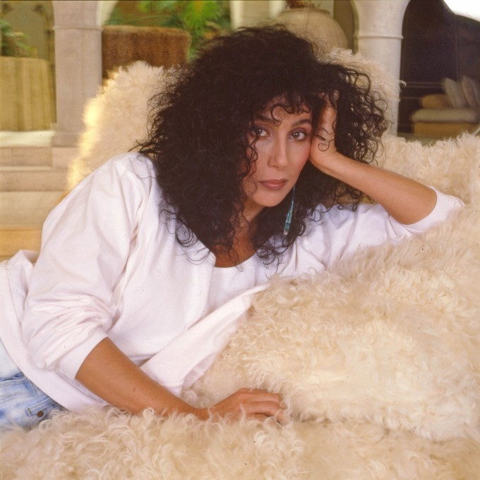 Cher frizzy 80s hairstyle