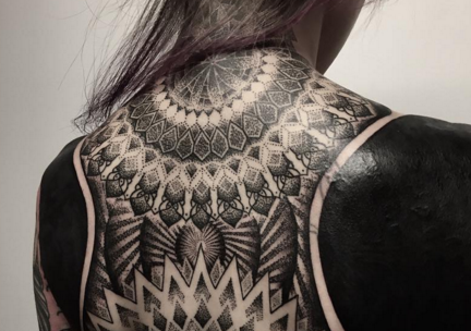 The latest all-black tattoo trend is