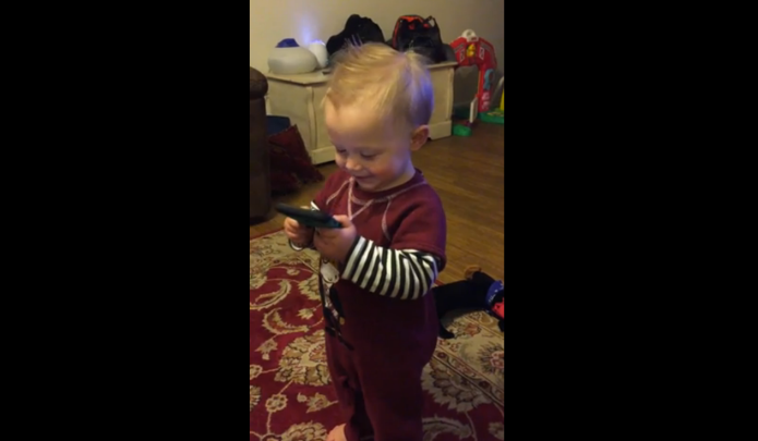 Toddler gets a phone call from