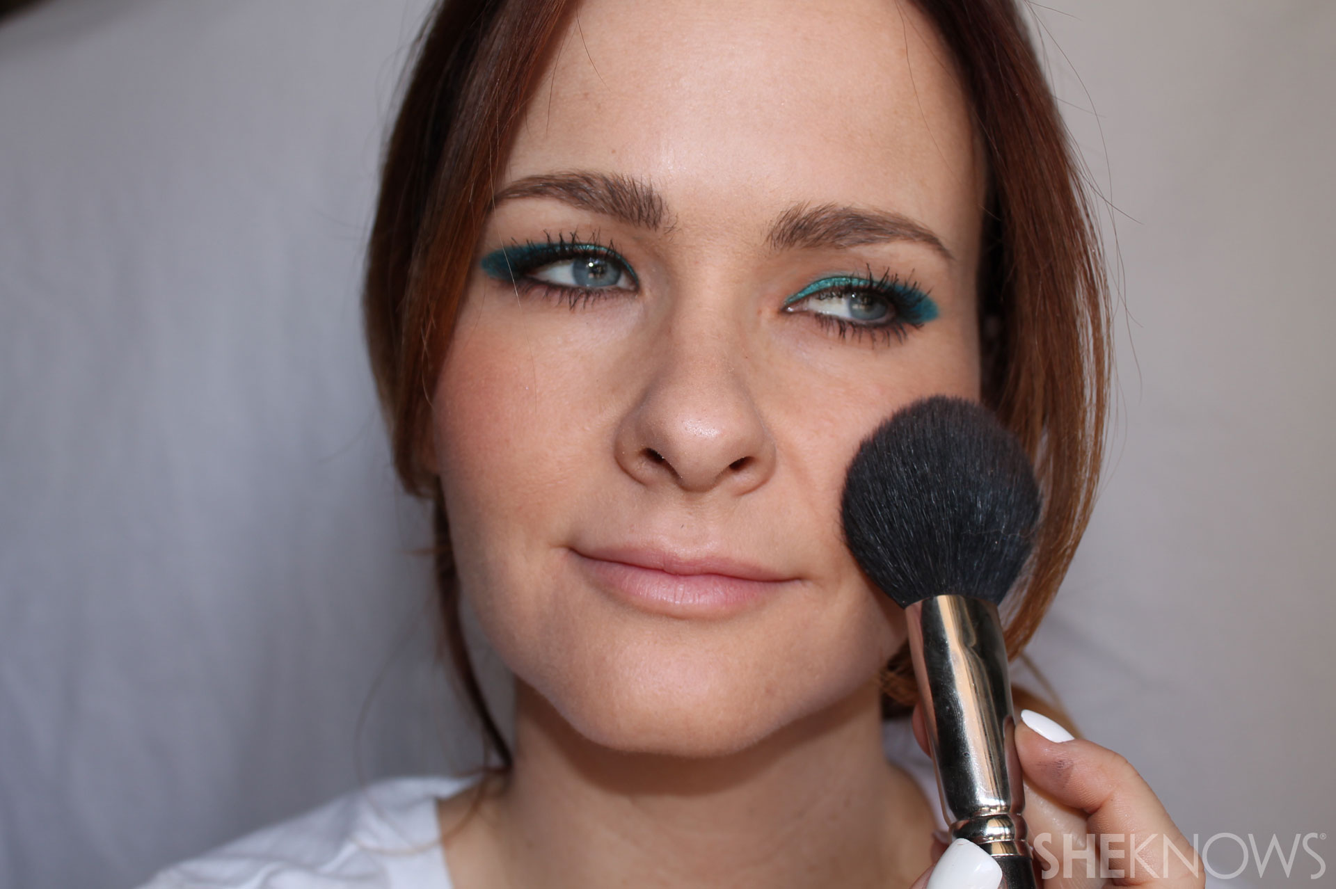 DIY Bold eyeliner: Use soft pink or peach blush
