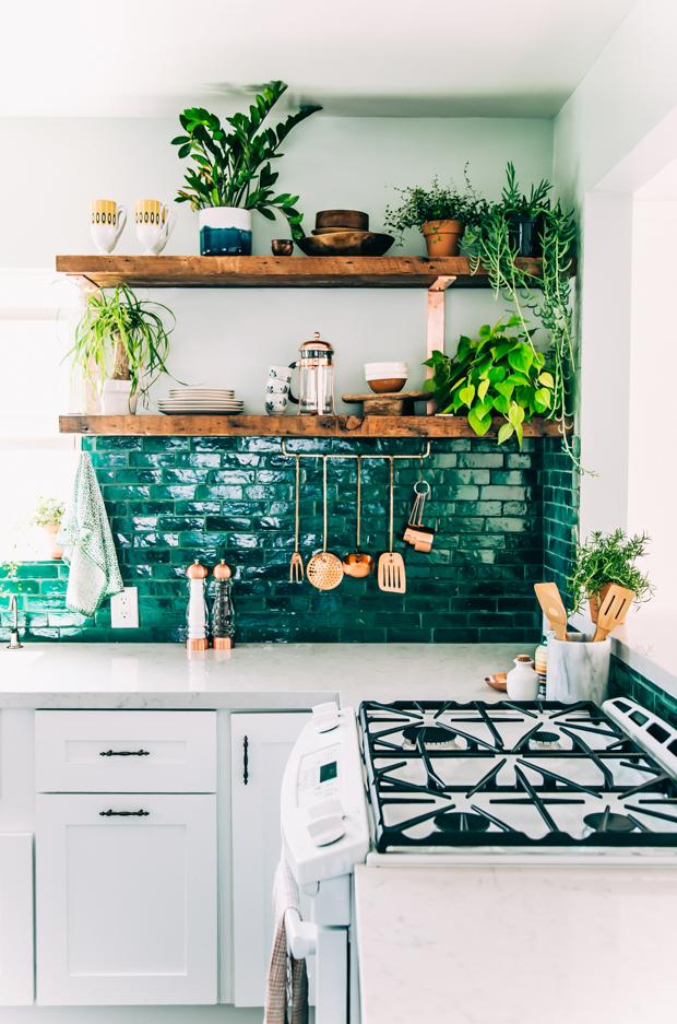 Green tiles add a pop of color to your backsplash