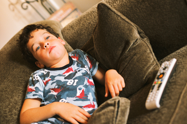 boy bored on couch