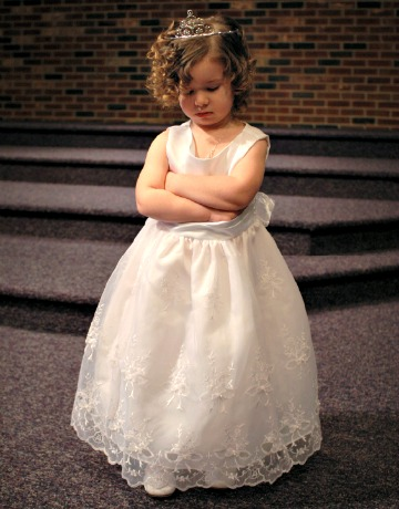 Bored flower girl at wedding reception