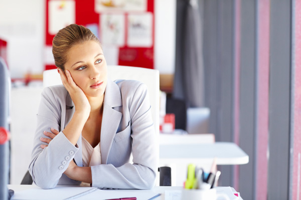 Bored woman at desk