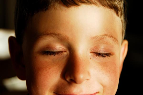 Boy closing eyes