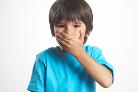 Boy covering mouth | Sheknows.com