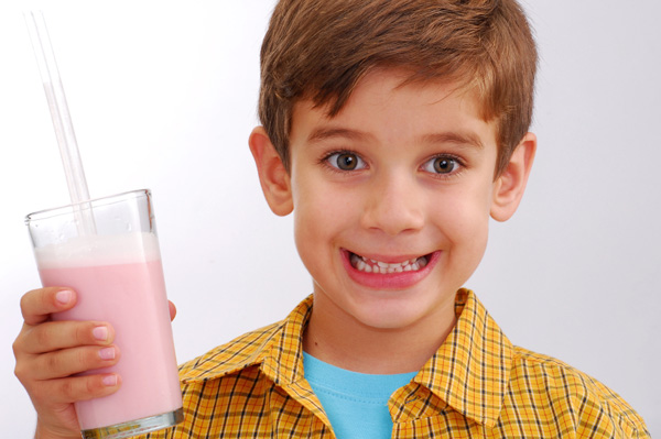 boy drinking a smoothie for snack