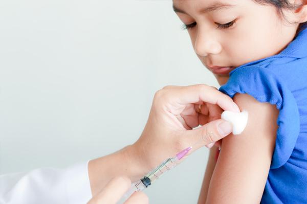 Boy getting vaccine