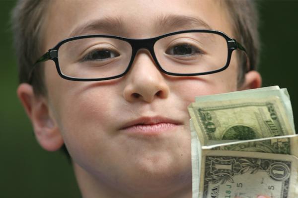 Boy holding his allowance