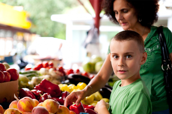 Mom and boy at farmer's market