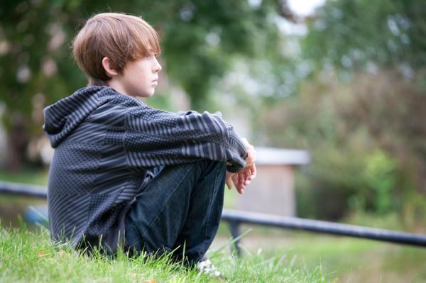 Boy sitting and thinking