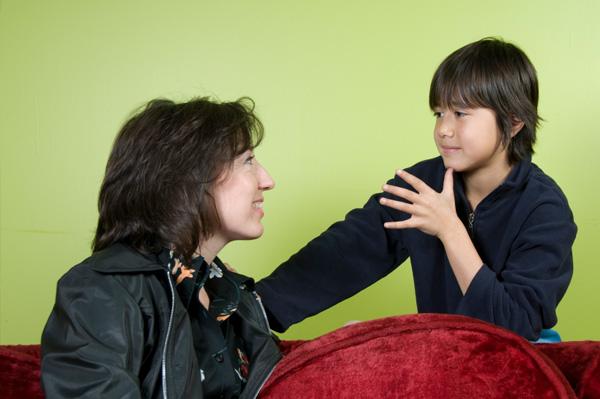 Boy using sign language