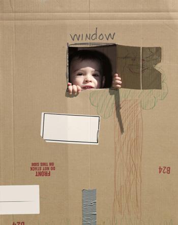 Boy with cardboard fort