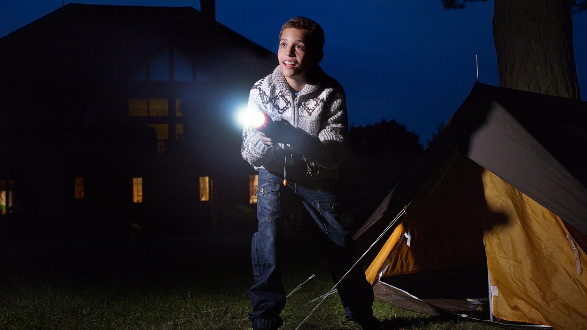 Boy with flashlight | Sheknows.com