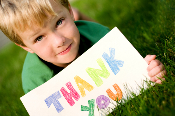 Boy with thank you card