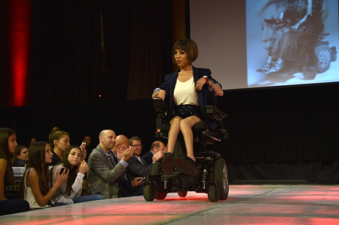 Jillian Mercado in wheelchair on runway