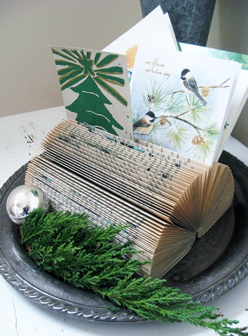 holiday card display in pages of book
