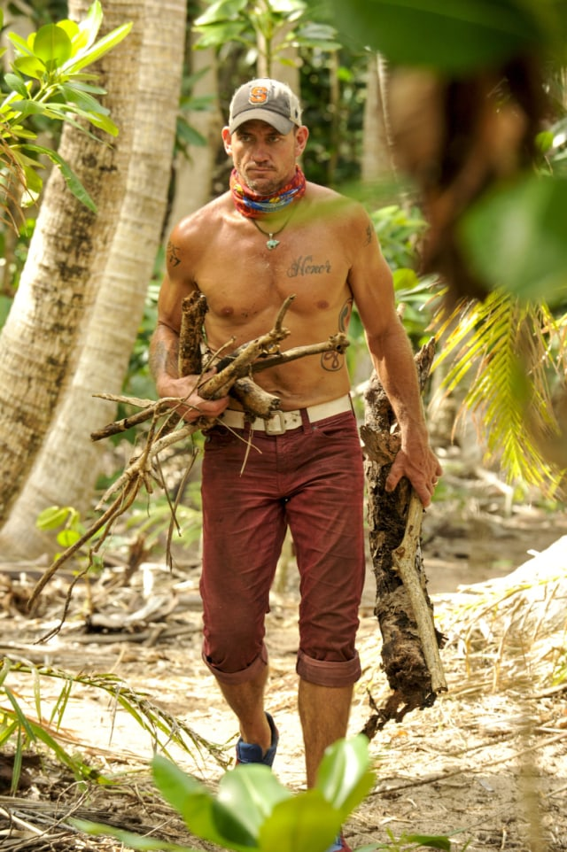 Brad Culpepper works at camp on Survivor: Game Changers