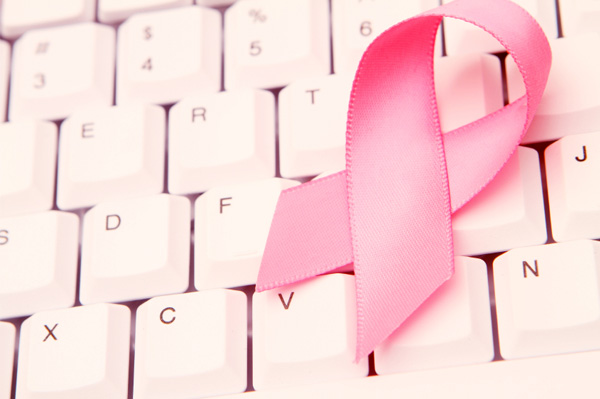 Breast Cancer ribbon on computer