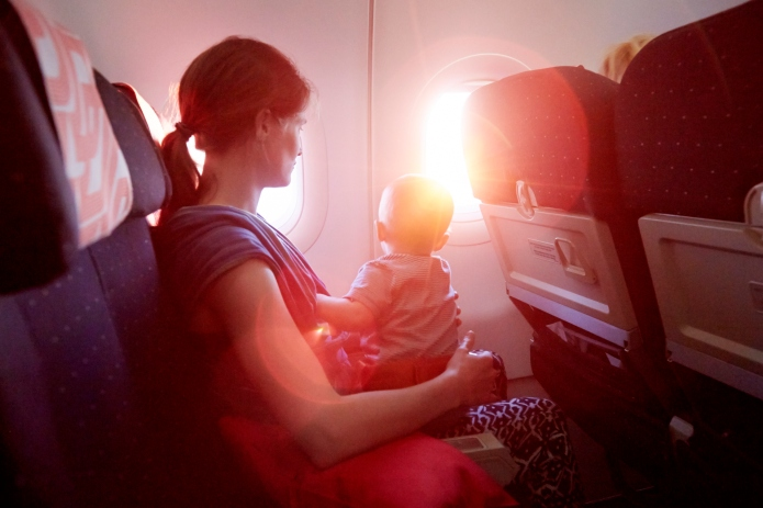Mother and Baby on airplane looking