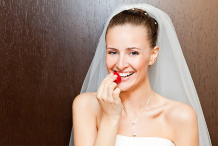 Bride eating berry
