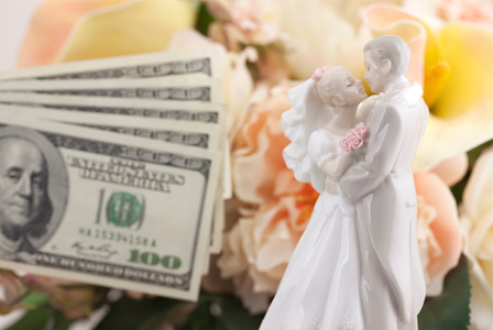 Bride and groom with cash