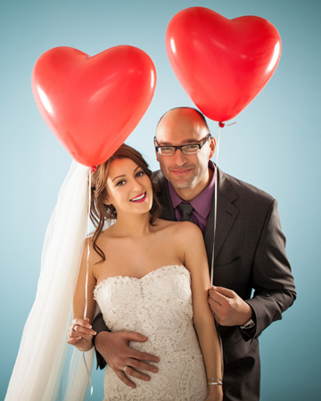 Bride and groom with heart balloons