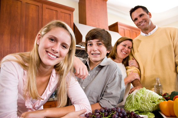 Busy family in kitchen
