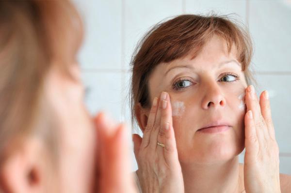 Busy mom applying lotion