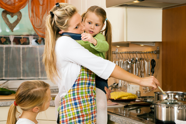 busy mom in kitchen with kids