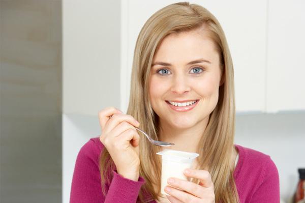 Busy mom eating yogurt