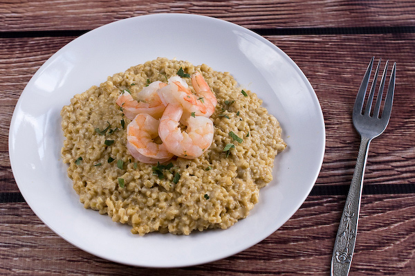 Butter poached butterflied shrimp and steel-cut oat risotto