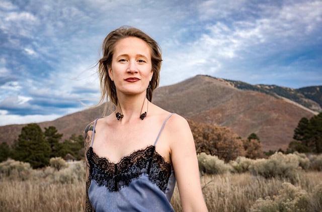 Rachel Rae Halder outdoor portrait with mountains