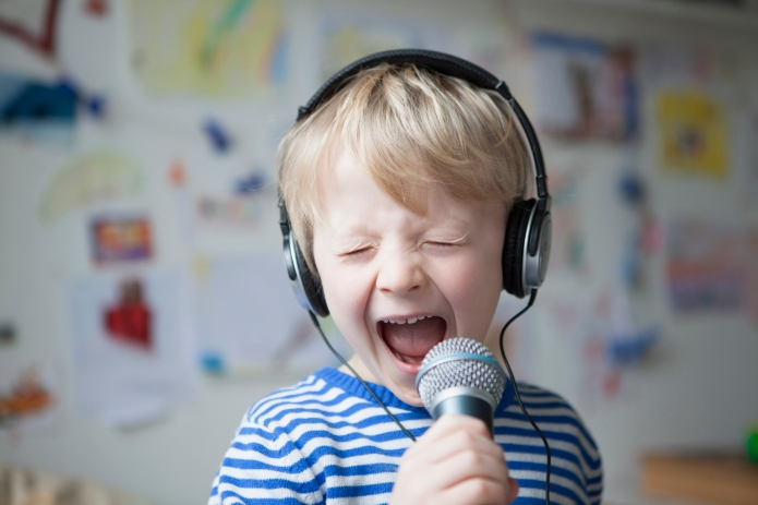 Portrait of singing little boy with