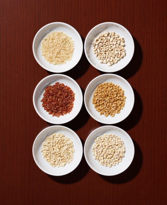 Bowls of grains on a table.