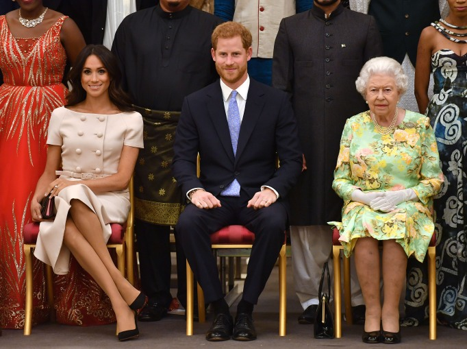 Meghan Markle, Prince Harry and Queen Elizabeth at the Queen's Young Leaders Awards Ceremony