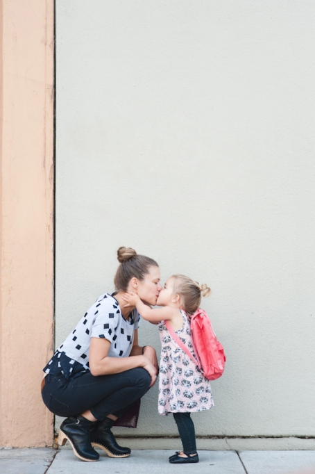 Mom & daughter first-day kisses