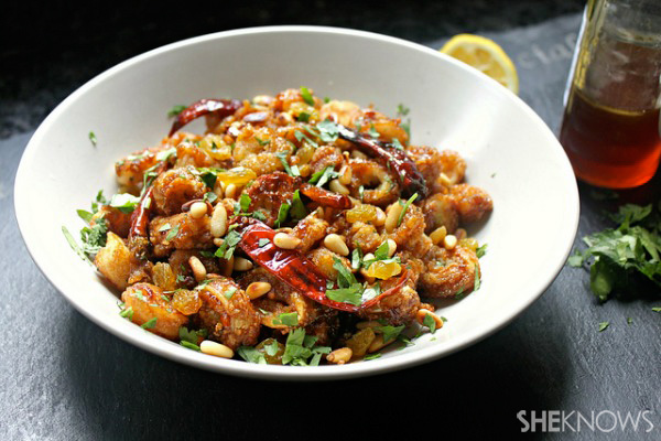 Fried calamari with honey-soy reduction, toasted pine nuts and raisins