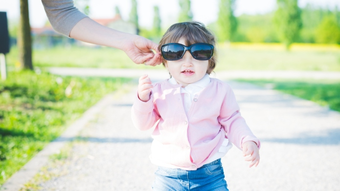 Portrait of female toddler wearing sunglasses