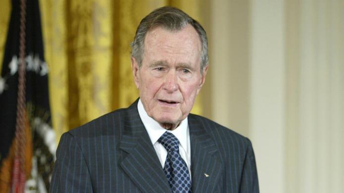 President George H.W. Bush parachutes for