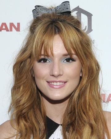Bella Thorne's half up half down hairstyle