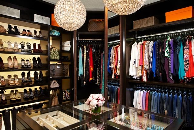 closet with round chandelier