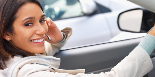 Woman in Car on Cell Phone