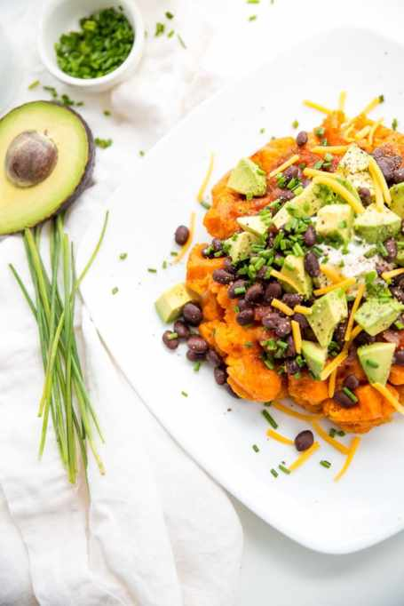 11 Sweet and Savory Waffle Recipes: Sweet potatoes are topped with a savory black bean topping in this recipe.