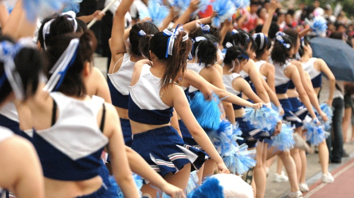 Row of dancing cheerleading women, Taiwan,