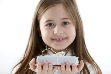 Child giving teacher a gift